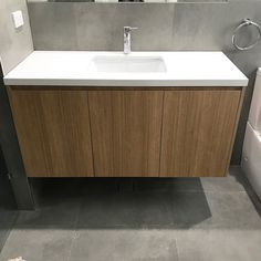 Loving the timber finish of our custom designed vanity which creates warmth against the grey  concrete floor and wall tiles  Interior design by #cravedesignstudio . . . . . #stone #caesarstone #marble #concrete #tiles #bathroom #vanity #bathroomdesign #development #construction #building #finishes #interior #design #interiordesign #interiordesigner #sydney #architecture #realestate #sydney