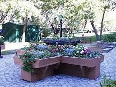 Raised flower bed is designed in the shape of an X
