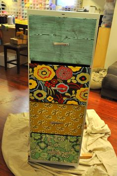 fabric front file cabinet makeover - part 1  ...there appears to be no part 2 tagged on her blog. :(