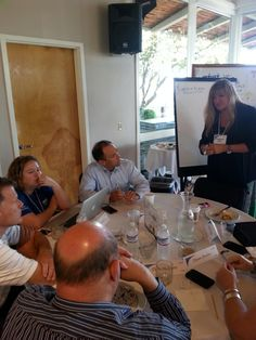 Deborah Defer and her team in a think tank session at #IntuitSummit
