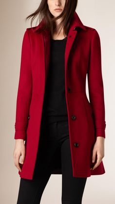 A trench coat in warm Italian-woven wool and cashmere. The slim, paneled design has a pleated skirt with a buttoned vent at the back.