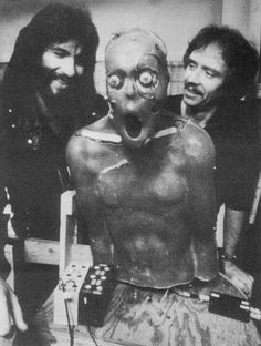 Special effects artist Rob Bottin (left) posing with director John Carpenter (Right) and one of the many creatures in The Thing (1982)