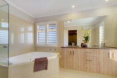 The master bedroom's ensuite features a luxury spa to relax and unwind.
