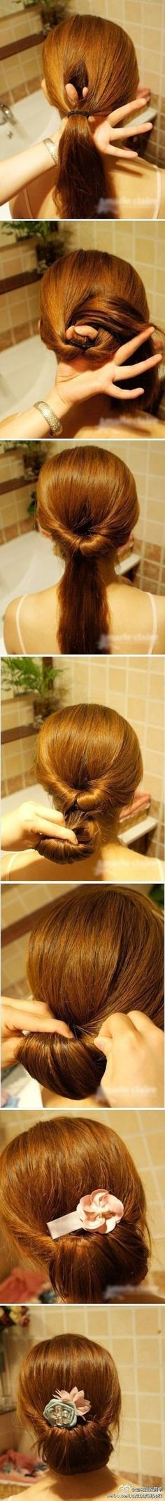 Lower, burrito-looking horizontal bun. Needs to be held with a hair clip (bobby pins).