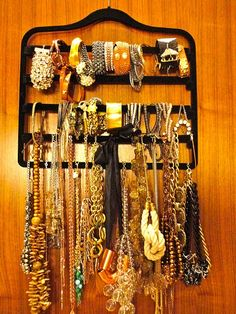 velvet pants hanger turned jewelry organizer.  I see these in Ross, TJ, and Marshalls all the time!