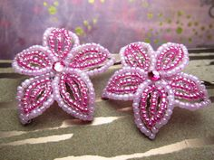 Two french beaded flower hair bobby pins in:  Alluring fuchsia with soft lilac borders. Bright, inviting, and warm.    They are each attached a hardware