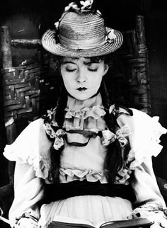 Lillian Gish reads in Romance of Happy Valley, 1919.