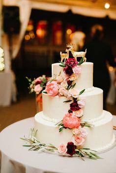 Buttercream Wedding Cake with Roses, Deer Topper | Colonial Farms Bakery | A Garden Party https://www.theknot.com/marketplace/a-garden-party-elmer-nj-615122 | LongBrook Photography https://www.theknot.com/marketplace/longbrook-photography-haverford-pa-609002