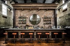 Ice Plant, an ultra-hip bar and restaurant with a retro theme and modern Southern menu, occupies a painstakingly restored onetime ice factory.