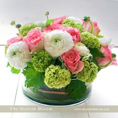 Fresh and spring time pretty.  I am going to have to remember to use some of my old tins to do floral arrangements!
