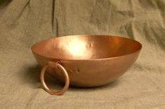 Egg Bowl  Handmade by Peter Goebel. Historic reproduction. Raised from the plate, this 32oz copper bowl is styled after a larger egg white mixing bowl found in Diderot's Encyclopedia. Use this for the perfect whipped egg whites, or to make Glair. It measures about 7 inches across, and 2 1/2 inches deep. Has a nice heavy hanging ring.  Copper. French, dated to about 1750.  http://www.goosebay-workshops.com/Cooking-and-Baking-Utensils