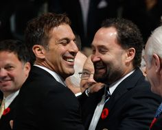 Shanny & Cheli drop the puck at a Leafs game after receiving their Hockey Hall of Fame rings. (11/8/13)