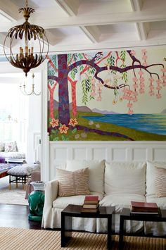 Living room with cool mural.
