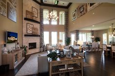 Toll Brothers - Sandhaven Family Room love the corner fireplace and so much open space between family room and kitchen