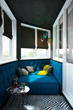 Modern home interior, awesome blue seating and graphic floor tiles