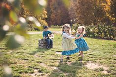 Children dance happily in knot dresses... little boy playing guitar www.facebook.com/whitedaffodilphotography
