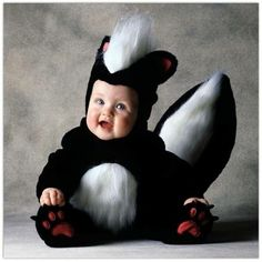 Even dressed as a skunk cannot hide how adorable this baby is #babies #kids #Halloween #costumes