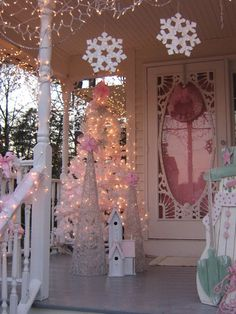Pretty Pink Christmas with tree, wreath, church on old fashioned porch  #Church #Prettypink #Christmas