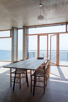 As a young boy, the architect sailed on Flensburg Fjord and dreamed about living right here - The architect's concrete home . Architect House, Wood Surface, Painting On Wood, Concrete, Brick, Windows, Interior Design, Architecture, Modern