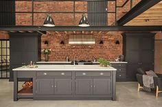 Industrial style shaker kitchen painted in charcoal grey against an exposed brick wall and featuring lots of original features. Kitchen by Tom Howley Industrial Kitchen Design, Industrial House, Modern Kitchen Design, Interior Design Kitchen, Modern Interior Design, Modern Industrial, Industrial Table, Industrial Bookshelf, Industrial Windows