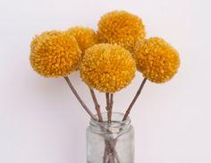 pretty yarn pom pom flowers - wanna make some!