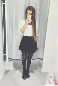 Basic Outfit: White Medium Length Crop Top, Black Skater Skirt, Black Sheer Tights & Black Combat Boots