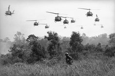 Hovering U. Army helicopters pour machine-gun fire into tree lines to cover the advance of Vietnamese ground troops in an attack on a Viet Cong camp 18 miles north of Tay Ninh, Vietnam, on March northwest of Saigon near the Cambodian border. Vietnam History, Vietnam War Photos, Vietnam Veterans, Vietnam Map, North Vietnam, War Photography, Military History, Military Photos, Cold War