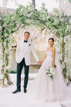 Photography : Anna Roussos | Wedding Dress : Mira Zwillinger | Grooms Attire : Tom Ford Read More on SMP: http://www.stylemepretty.com/2016/11/07/this-greek-wedding-is-total-floral-goals/