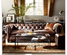 Exactly! Thank you PB! Gray walls, brown leather and black distressed wood.