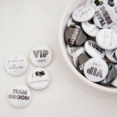 http://www.notonthehighstreet.com/twentyseven/product/pack-of-fifty-badge-wedding-favours