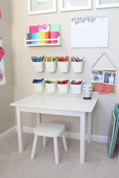 This playroom craft corner is so great! Its simple functional made for little crafters!
