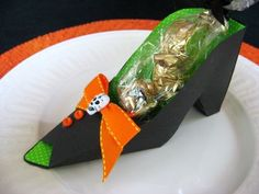 Paper Witch Shoes ~ Cutest party favor... perfect little container for yummy treats. Also they would be fun made with pretty paper for a little girls princess party, or a bridesmaid luncheon. They could even be done in red glitter for a Wizard of Oz party. To make the paper shoes download the template