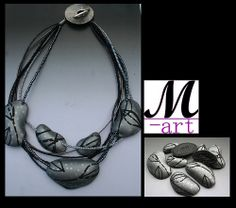 Marjon Donker necklace pillow beads inspired by the hollow beads of Christine Dumont.