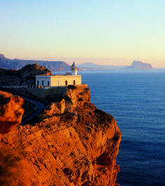 Albir, Spain. When I was 12 I lived a 45 min walk away from this lighthouse. I walked my dog here everyday. In the distance you can see Calpe, the view from my bedroom balcony.