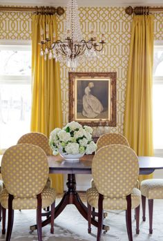 Tobi Fairley. Schumacher Imperial Trellis in Citrine wallpaper in this dining room.