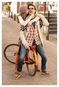 cute engagement photo with an old bike! love the bike color, his sunglasses, her hat! (flannel and cardigan and i can keep going...)