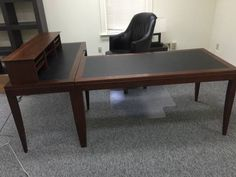 (2) TWO COPELAND OFFICE COMPUTER DESK WITH KEYBOARD TRAY AND ONE LEATHER CHAIR. QUALITY CHERRY HARD WOOD OFFICE DESK WITH LEATHER INSERT TOP ALSO COMES WITH FREE BLACK METAL BOOK SHELVES CASE . WORTH
