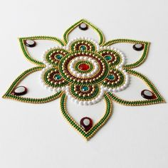 Shop Jasmine Shape Kundan Rangoli_for Navaratri by Dipti Art & Craft online. Largest collection of Latest Decoratives online. ✻ 100% Genuine Products ✻ Easy Returns ✻ Timely Delivery