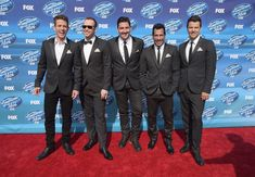 """Joey McIntyre Photos Photos - Joey McIntyre, Donnie Wahlberg, Jonathan Knight, Danny Wood and Jordan Knight of New Kids On The Block attend the """"American Idol"""" XIV Grand Finale event at the Dolby Theatre on May 13, 2015 in Hollywood, California. - 'American Idol' XIV Grand Finale - Arrivals"""