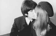 "marsmusiclove: "" Sneaky kiss George Harrison sneaking a kiss on his wedding day with Pattie Boyd "" The day after the wedding on January 22, 1966 during post wedding press conference at NEMS."