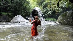 A Hindu devotee takes a dip in the Bagmati River before heading towards the Pashupatinath Temple to offer prayers to Lord Shiva in Sundarijal on the outskirts of Kathmandu.
