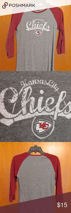 "Ladies Kansas City Chiefs Tee Shirt Great Tee-Shirt for Chiefs fans! I was never able to wear it because it is too small. But it was a gift from my Chiefs fan hubby, so I kept it anyway. Usually Medium fits me but this runs small IMO. This is from the NFL shop and I can't find it there now, so they may not be making it anymore. The writing and team logo are in ""distressed"" style. Sleeves are 3/4 length. It has been washed 1 time and never worn, other than to try it on only to find it too…"