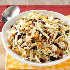 Cranberry Walnut Slaw Recipe -I make this every year for the holidays. It's a healthy alternative to traditional coleslaw made with mayo. For a alternate flavor combination, substitute toasted sesame seeds and sesame seed oil for the walnuts and walnut oil, and rice wine vinegar for the white wine vinegar. —Bob Nopper, Salem, New York