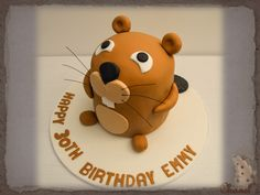 Cartoon Beaver Cake.......Cartoon Beaver Shaped cake, Covered in Brown Fondant and decorated with fondant Tummy, Feet, Arms, Jowls, Teeth, Nose, Eyes, Ears & Tail. with black wire whiskers. Sating on a Birthday Board.