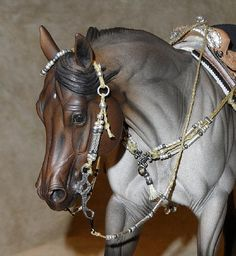 MH$P Ad: BRAIDED SILVER/ GUNMETAL BRIDLE AND BREAST COLLAR