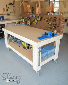 New Workbench Baby! A simple DIY workbench that's perfect for any garage or workspace! How-To Tutorial from simple DIY workbench that's perfect for any garage or workspace! How-To Tutorial from Woodworking Bench, Woodworking Crafts, Woodworking Shop, Woodworking Classes, Building A Workbench, Workbench Plans, Workbench Top, Industrial Workbench, Folding Workbench