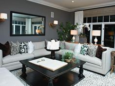 Playful arm sconces, sophisticated fabrics, and a customized rug make up this eclectic family room.