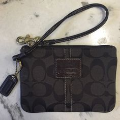 "COACH NWOT wristlet Dark Brown Never used, new condition!  Coach Wristlet is dark brown wth signature print and plaid lining.   6"" x 4"".  Fits IPhone 6! Coach Bags Clutches & Wristlets"