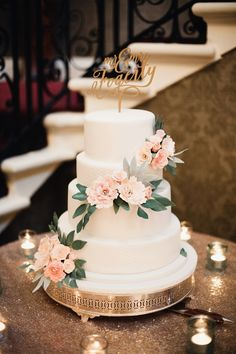 Simple and elegant - Iced, Tiered Cake. Image by Claire Macintyre
