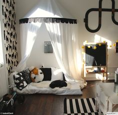 Black and white boy room canopy bed